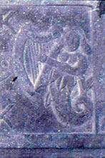 Detail of the mermaid on the right side of the Kilcoy Castle mantle carving.