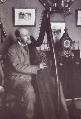 Portrait of Robert Bruce Armstrong playing his wire-strung Egan