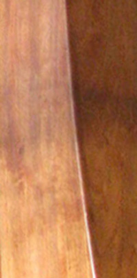 Photograph of a section of a harp made out of Cherry