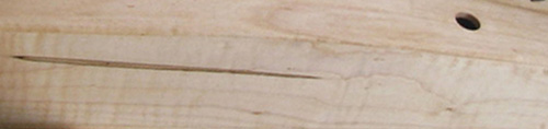 Photograph of a section of a harp made out of Hard Maple