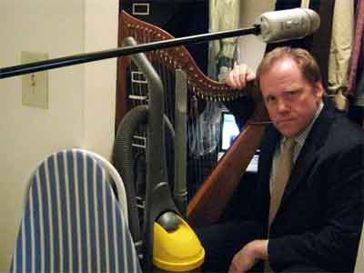 photograph of Scott in a closet with his harp