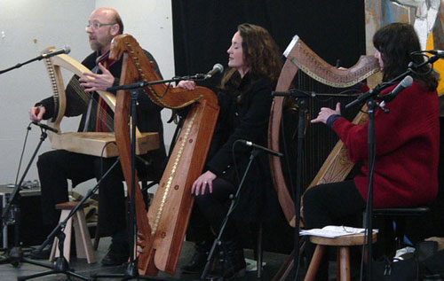 A photograph of three harpers on stage for the lunchtime recital